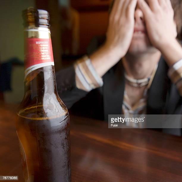 Pensive Man at a Bar