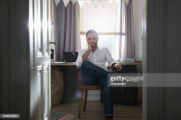pensive man at his home office - elegante kleidung stock-fotos und bilder