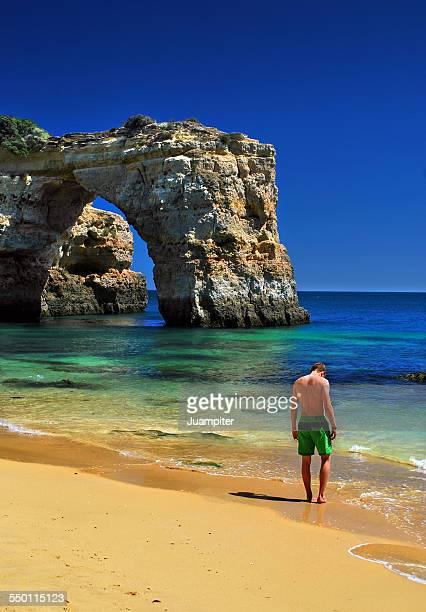 pensive man on a beach in Algarve