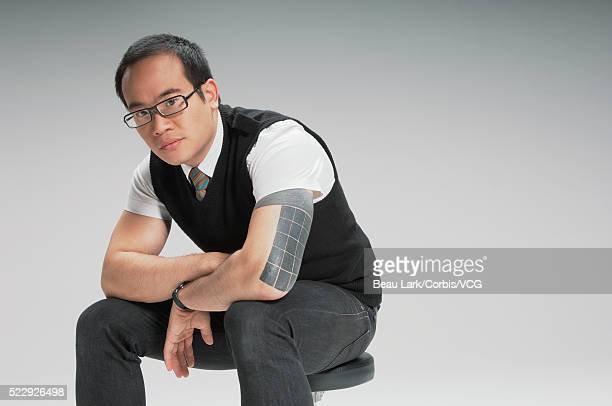 Pensive man sitting on a stool