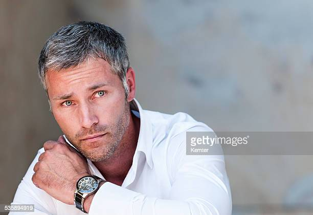 pensive man with grey hair - handsome muscle men stock photos and pictures