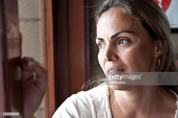 Pensive Mature Hispanic Woman