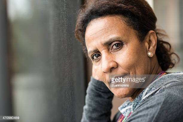 pensive mature woman - serious stock pictures, royalty-free photos & images
