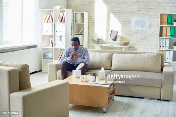 pensive patient at psychiatrists office - psychiatrist's couch stock pictures, royalty-free photos & images