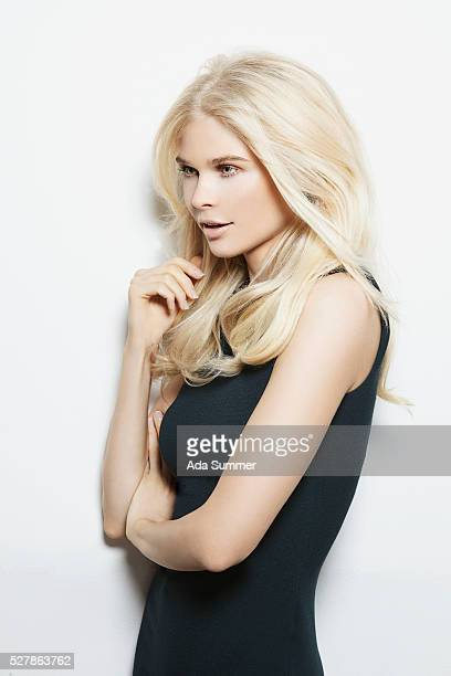 pensive platinum blond woman - cocktail dress stock pictures, royalty-free photos & images