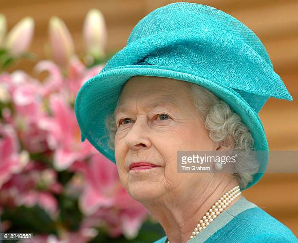 Pensive portrait of Queen Elizabeth II during a visit to the Royal Horticultural Society Garden at Wisley where as RHS Patron she officially opened...