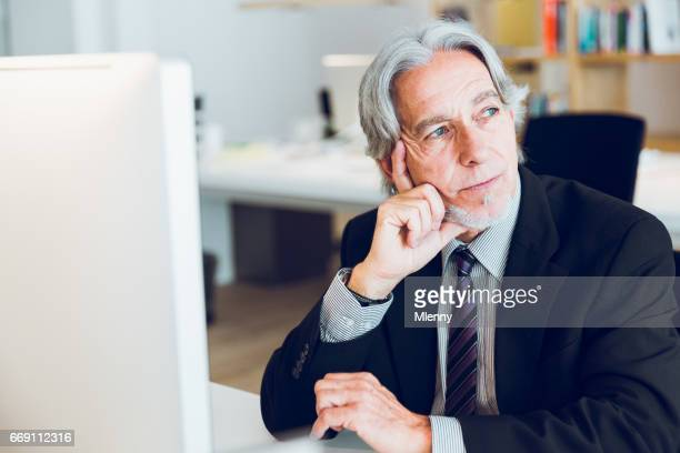 Pensive Senior Manager Thinking About Business Problems