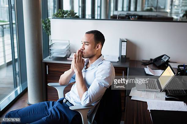 Pensive Serious Businessman Working Late