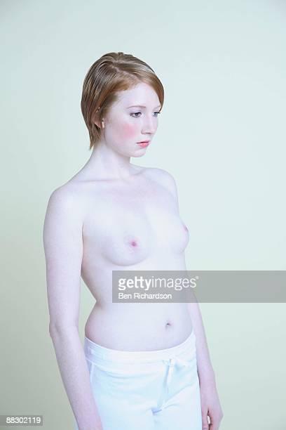 Pensive topless woman
