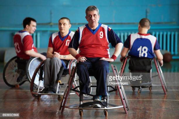 Pensive wheelchair basketball players