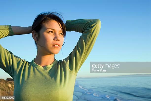 Pensive woman by seashore