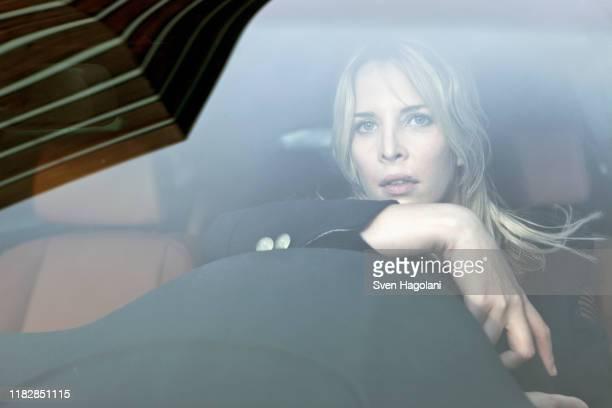 pensive woman driving - starren stock-fotos und bilder