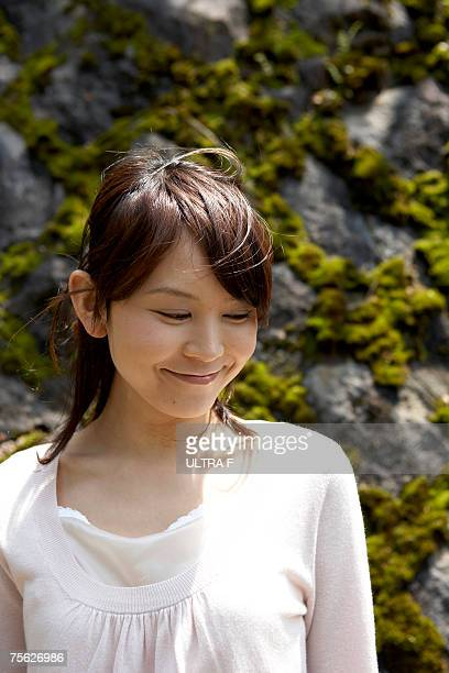 pensive woman looking down, outdoors - down blouse stock pictures, royalty-free photos & images