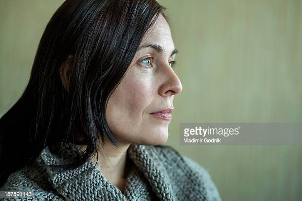pensive woman looking into distance - blank expression stock pictures, royalty-free photos & images