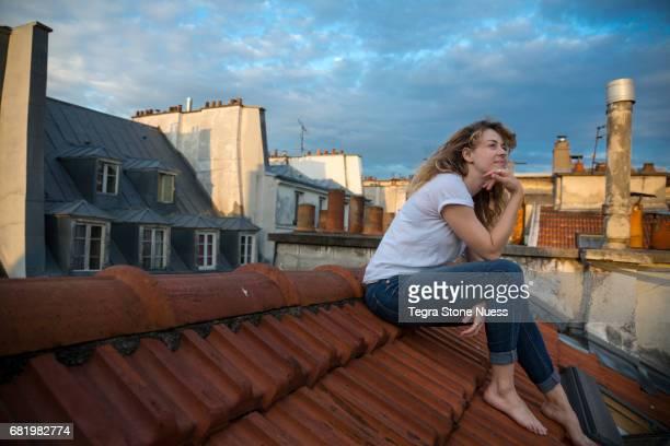 Pensive woman on Paris rooftop