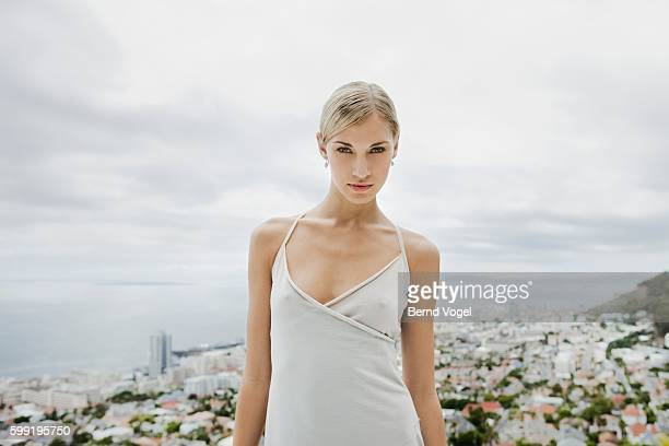 pensive woman wearing a dress - arrogance stock pictures, royalty-free photos & images