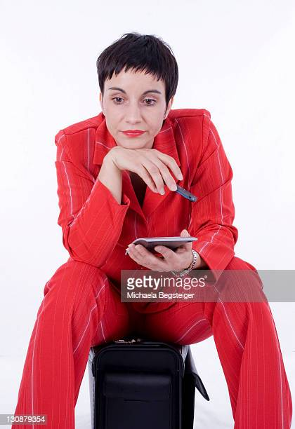 Pensive woman with a calculator