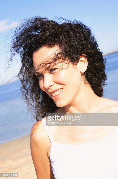 Pensive woman with windswept hair