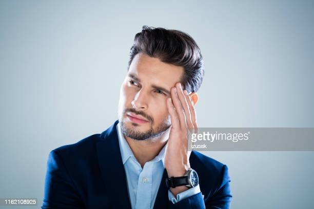 pensive young businessman - izusek stock pictures, royalty-free photos & images