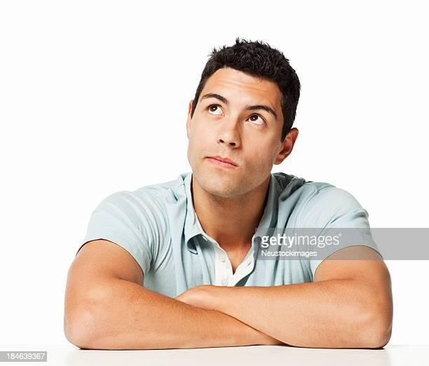 pensieroso giovane uomo isolato - braccia incrociate foto e immagini stock