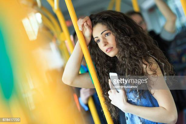 Pensive young woman traveling with bus