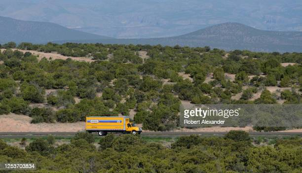 Penske rental truck travels along a rural highway near Santa Fe New Mexico