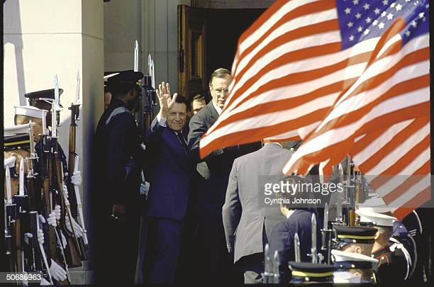 Pentagon ceremony during arrival/departure of Pres Ronald W Reagan Def Secy Caspar W Weinberger waving and VP George H W Bush