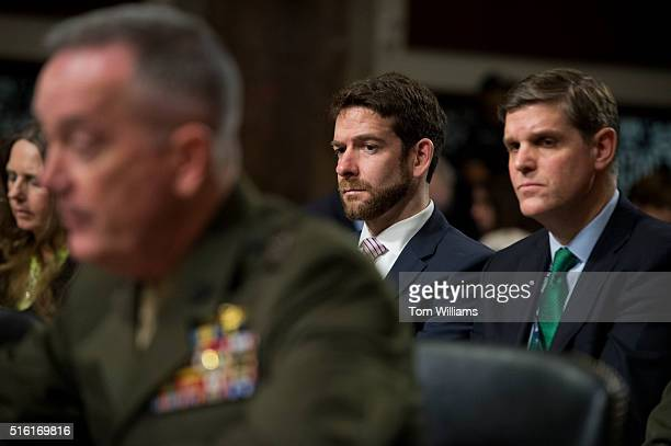 Pentagon spokesman Peter Cook right and Stephen Hedger Assistant Secretary of Defense for Legislative Affairs appear behind Chairman of the Joint...