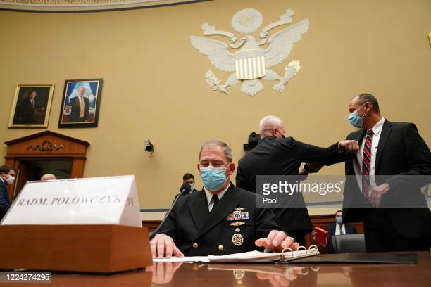 Pentagon Supply Chain Stabilization Task Force Vice Director of Logistics Rear Admiral John Polowczyk waits to testify as his fellow witness US...