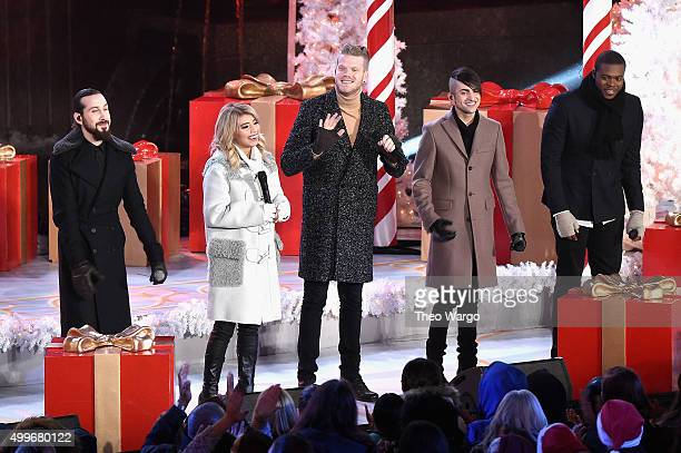 Pentatonix members Avi Kaplan Kirstie Maldonado Scott Hoying Mitch Grassi and Kevin Olusola perform onstage during the 83rd Rockefeller Center Tree...