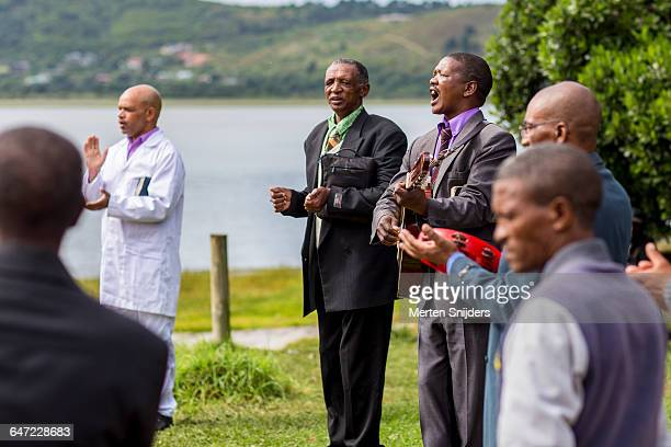 pentecostal baptism ceremony in knysna - pentecostalism stock pictures, royalty-free photos & images