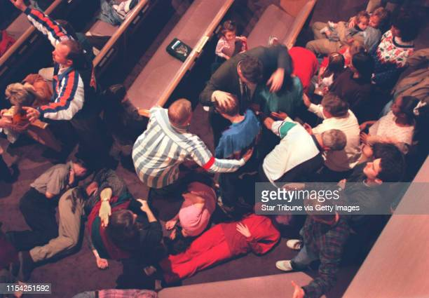 Pentecostal revival at the Brownsville Assembly of God. One of the pastors on staff prays over those responding to the altar call as some lie on the...