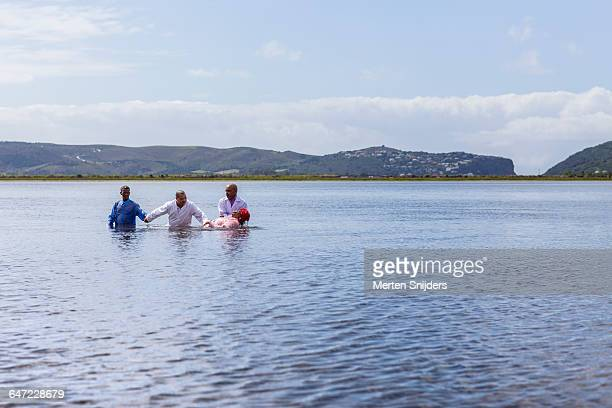 pentecostal water baptism in knysna lagoon - pentecostalism stock pictures, royalty-free photos & images
