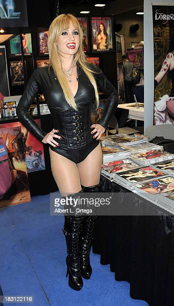 Penthouse Pet Angela Sommers attends Day 2 of the 2013 ComicCon International General Atmosphere held at San Diego Convention Center on Friday July...