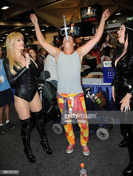Penthouse Pet Angela Sommers performer Murrugun T Mystic and model Anastasia Pierce attend Day 2 of the 2013 ComicCon International General...