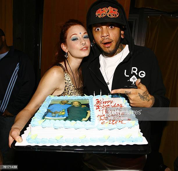 Penthouse Pet Justine Joli presents singer Travis McCoy his birthday cake at his birthday party at Angels and Kings on August 18 2007 in New York City