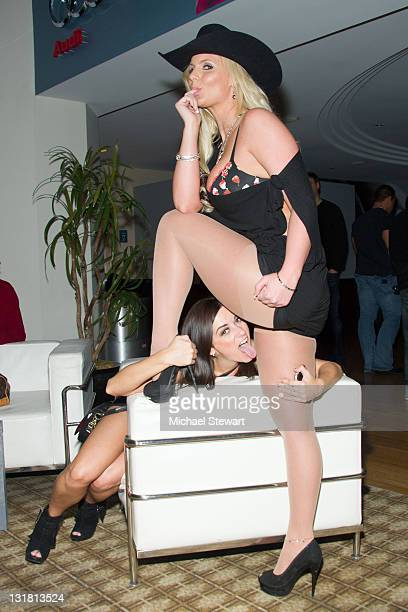 Penthouse Pet of the Year 2010 Taylor Vixen and Penthouse Pet Phoenix Marie and guest attend the Penthouse Super Party at American Airlines Center on...
