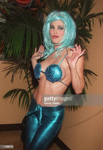Penthouse's 1993 Pet of the Year Julie Strain poses for photographers at the launch party for Bold Magazine at the Sunset Room September 28 2000 in...