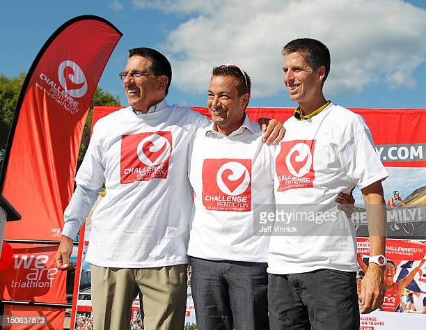 Penticton mayor Dan Ashton Challenge Family CEO Felix Walchshsfer and Canadian triathlete Peter Reid pose for a photo during a press conference on...