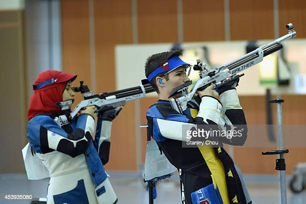 Peny Istvan of Hungary and Hadir Mekhimar of Egypt during the 10m Air Rifle Mixed International Teams Gold Medal Competition at the Fangshan Shooting...