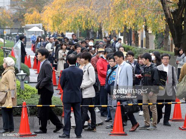 Peole line up seeking admission tickets for a judgment trial of Chisako Kakehi at the Kyoto district court on November 7 2017 Kakehi a onetime...