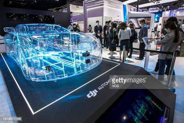 Peole visit DJI automotive booth during the 19th Shanghai International Automobile Industry Exhibition at National Exhibition and Convention Center...