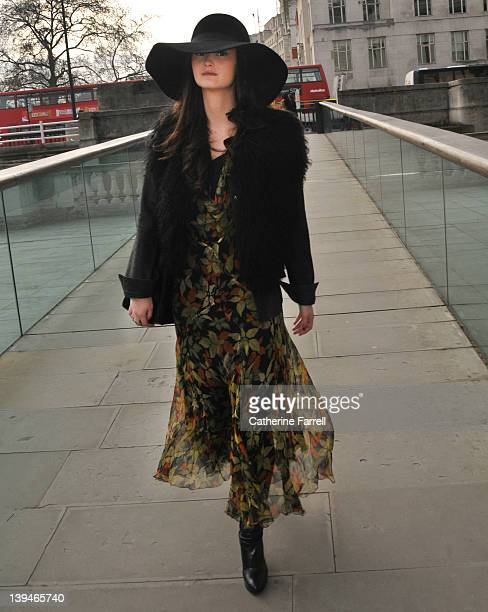 Peony Lim, Blogger, wearing russet and moss green autumunal leaf print vintage chiffon dress, black Zara jacket, Joseph hat and Fendi bag at London...