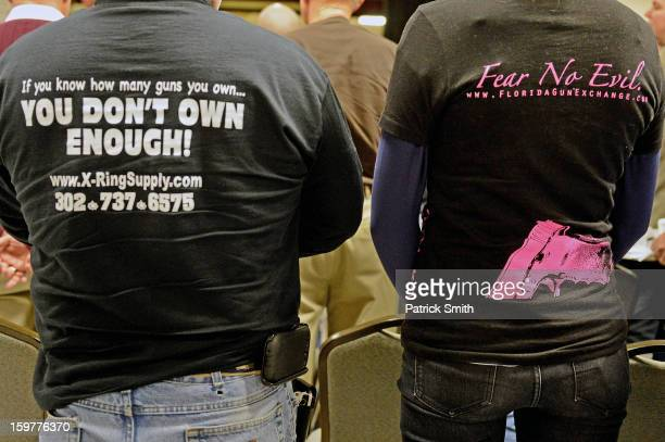 Peopel wear shirts supporting gun ownership during the Delaware State Sportsmen's Association Second Amendment rally at the Modern Maturity Center on...