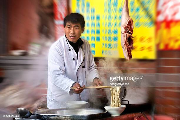 CONTENT] People a small stall sell popular beef n mutton soup along shanghai old street spotted with long queue of customers patronizing n notice the...