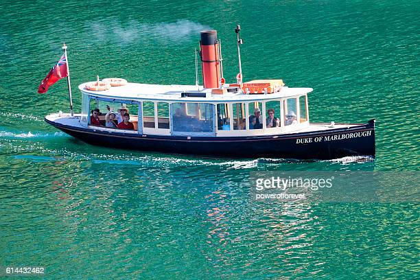 people aboard steamboat on the cook strait in new zealand - vintage steamship stock photos and pictures