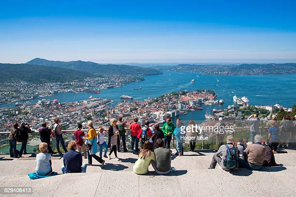People admire city and harbor view from Mt. Floien