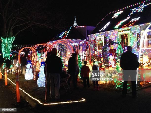 People Admire Holiday lights on Arthur Street in Danvers Ma on 12/21/14