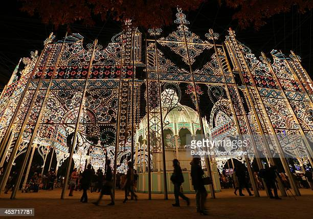 People admire the Luminarie illuminations as a part of the 19th Kobe Luminarie on December 5 2013 in Kobe Japan The annual illumination event which...