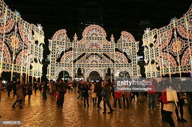 People admire the Luminarie illuminations as a part of the 20th Kobe Luminarie on December 4 2014 in Kobe Japan This year Kobe Luminarie will be held...